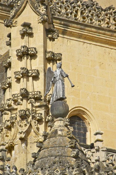 Lead angel playing trumpet cathedral Segovia Spain