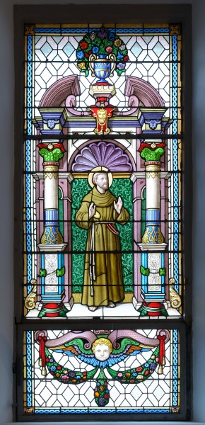 Saint Francis on stained glass window in the Saint Antony church in St. Ulrich in Gröden