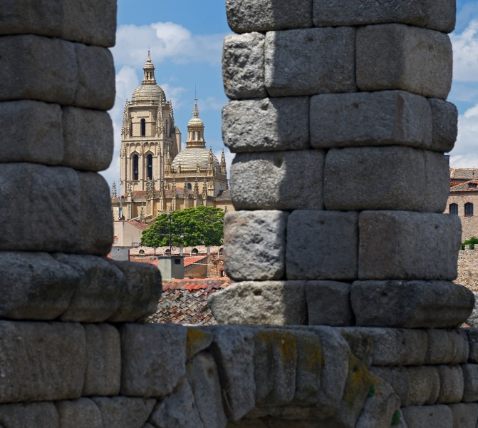 View of the Cathedral through the arches of the Aqueduct. Segovia, Spain