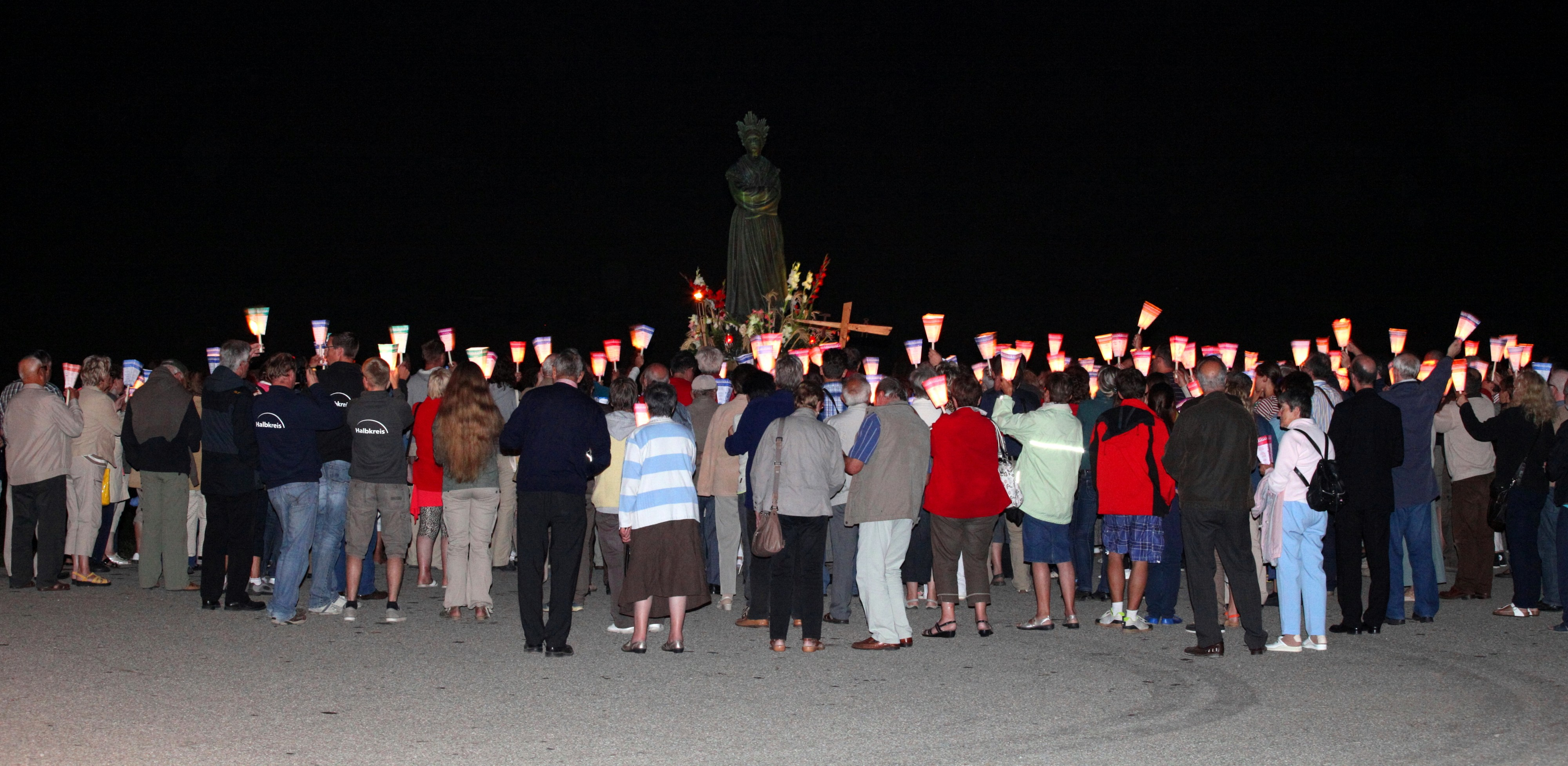 people with candles in the La Salette sanctuary, France, Europe, August 2013, picture 35