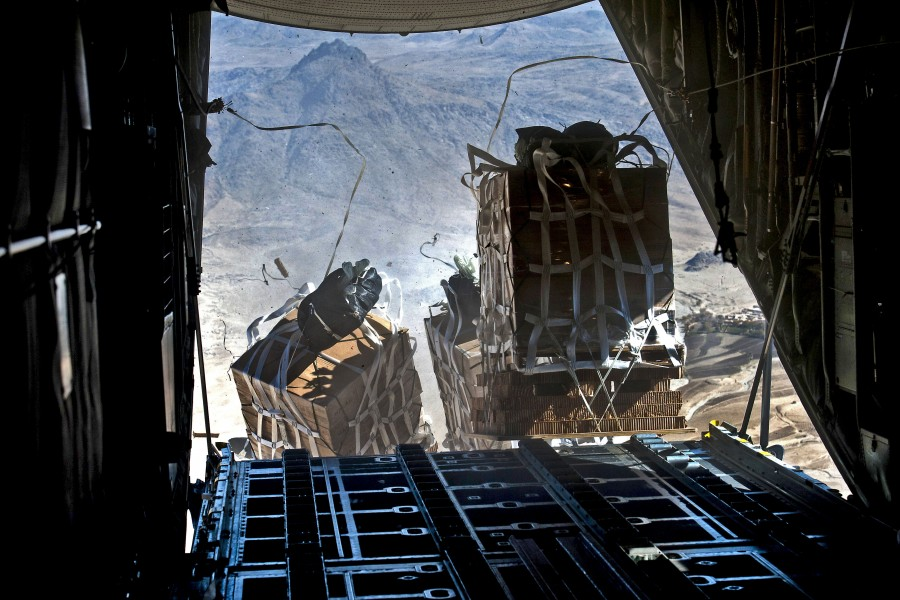 Defense.gov News Photo 111123-F-CP197-004 - Crews drop pallets of food and supplies from a U.S. Air Force C-130 Hercules aircraft over Bagram Airfield in Kandahar Afghanistan on Nov. 23