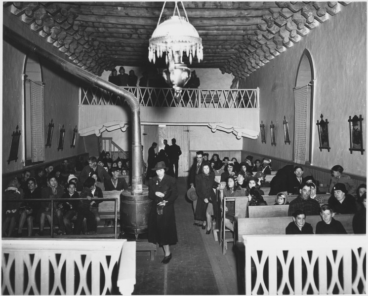 Taos County, New Mexico. Church fills up for Mass at Arroyo Hondo. - NARA - 521917