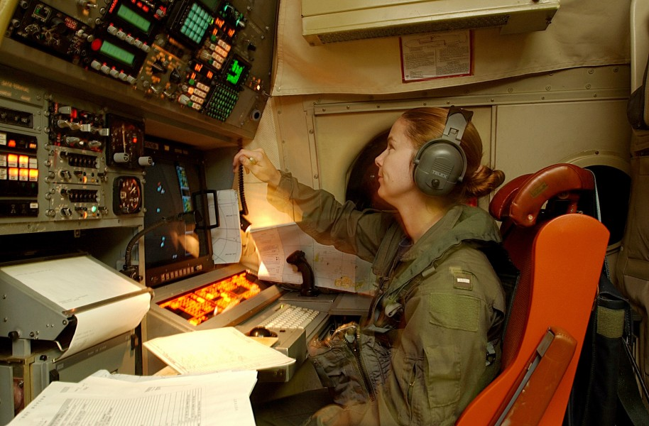 US Navy 030509-N-6501M-018 Lt. j.g. Karensa L. Heidmiller operates the navigation station aboard a P-3C Orion aircraft during a mission to the Republic of the Philippines