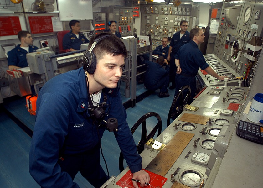 US Navy 030625-N-2819P-022 Machinist^rsquo,s Mate 3rd Class Christopher J. Rodrigue from Valentine, La., receives messages from the bridge