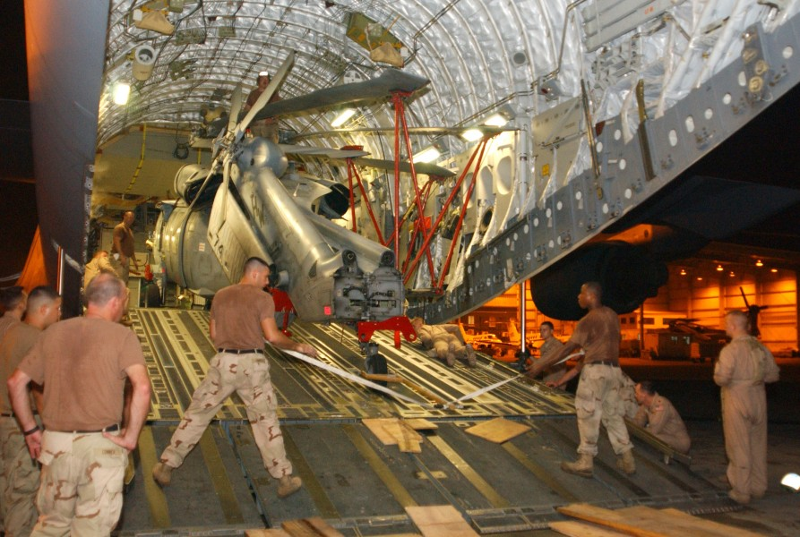 US Navy 051015-N-5863B-002 U.S. Navy helicopter loaded onto transport aircraft bound for Pakistan earthquake relief efforts