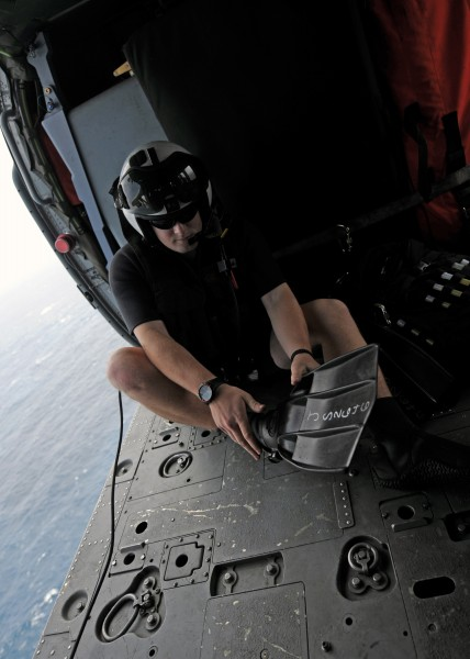 US Navy 101014-N-5016P-167 Naval Air Crewman 2nd Class Wesley Evans, assigned to Helicopter Sea Combat Squadron (HSC) 12, dons his rescue swimmer g