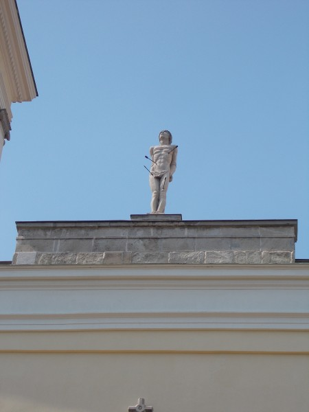 The statue of St. Sebastian (János Braun, 1978). 3 and half meters high, chalk artwork. At the top of Saint Sebastian church. Listed ID 3868. - Móri Street, Székesfehérvár, Fejér county, Hungary