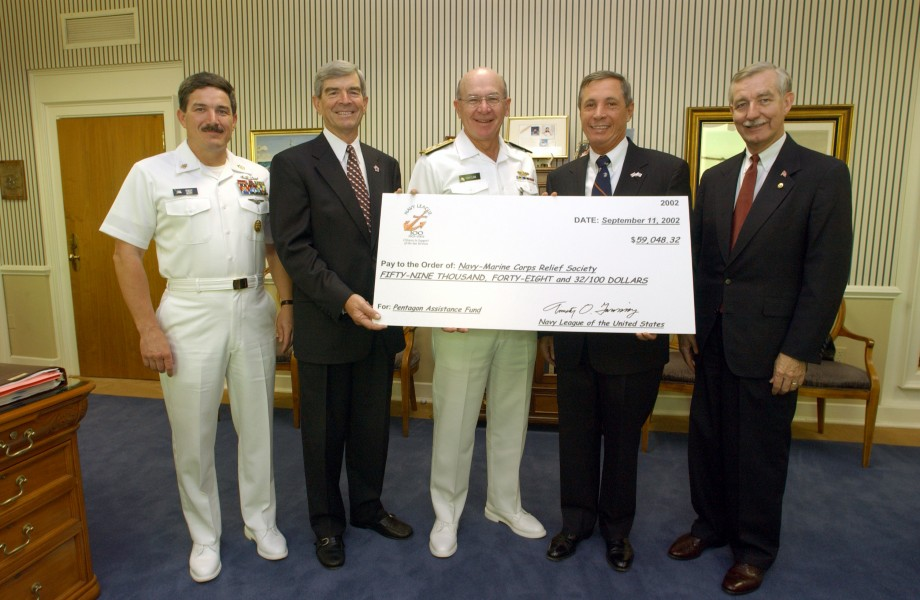 US Navy 020911-N-2383B-654 CNO and MCPON accept a donation from the Navy League