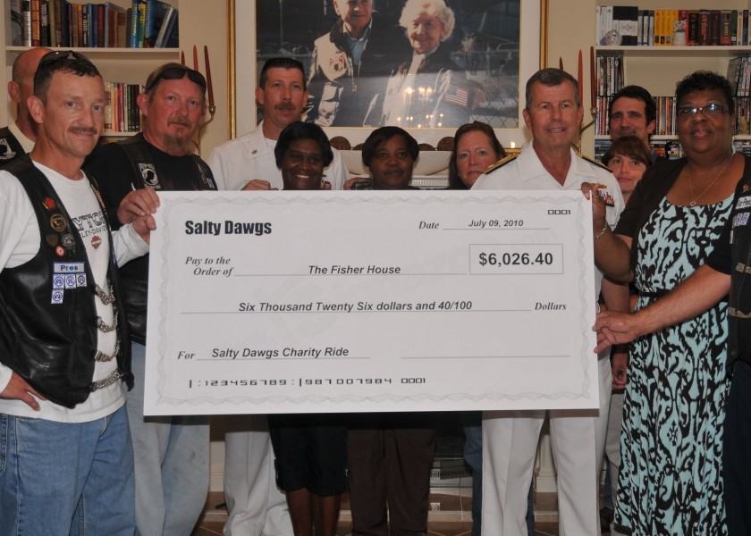 US Navy 100709-N-8361C-001 Rear Adm. Alton Stocks accepts a check for $6,026.42 on behalf of The Fisher House