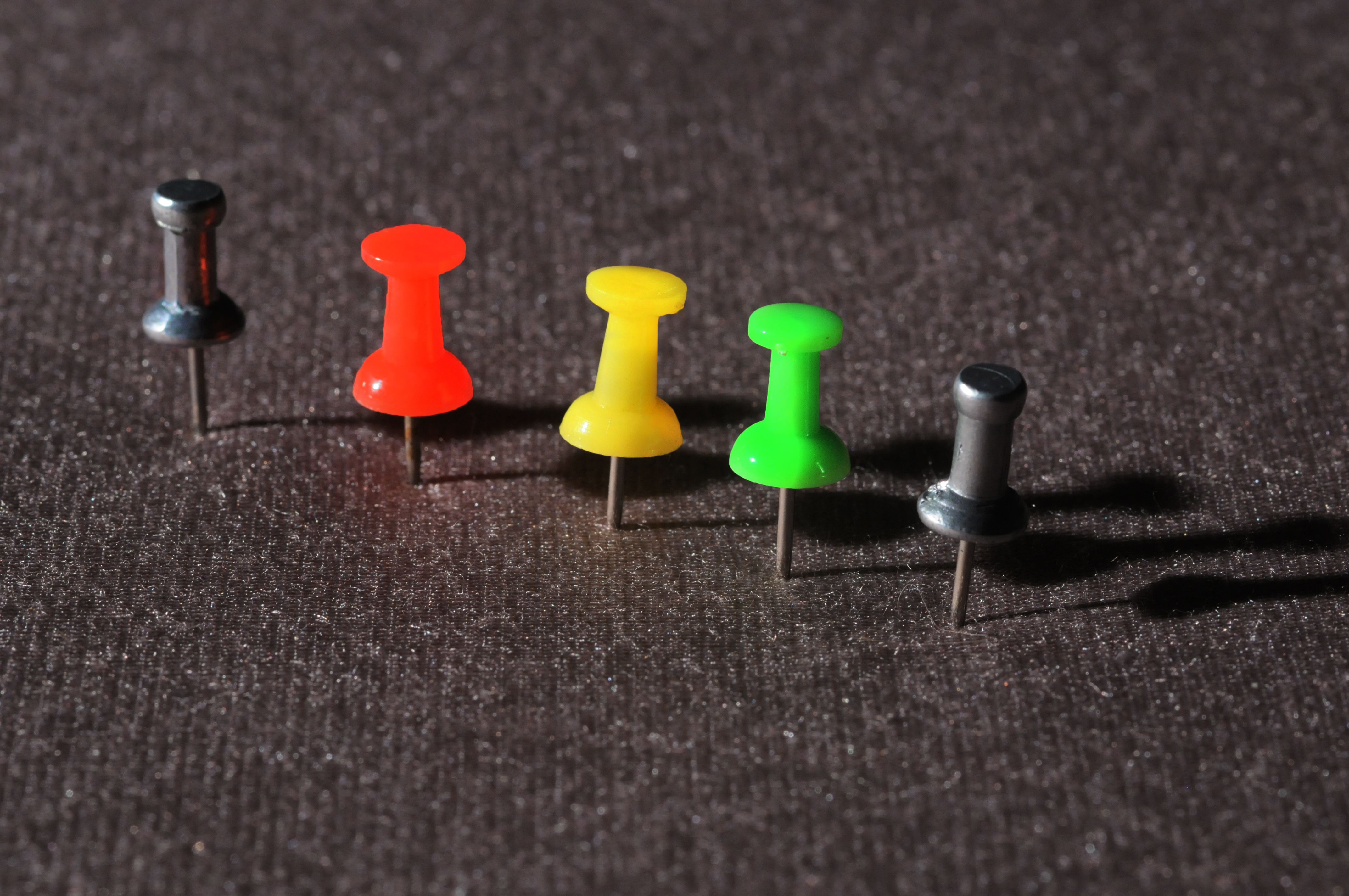 A line of colored pushpins