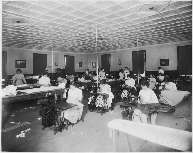 The School sewing room. Indian girls receive instruction in sewing, dressmaking, fancy sewing, drafting, darning... - NARA - 298641