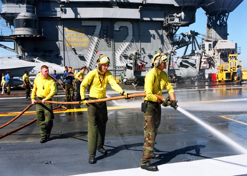 US Navy 030120-N-9403F-002 Sailors spray down sections of USS Abraham Lincoln's non-skid surface