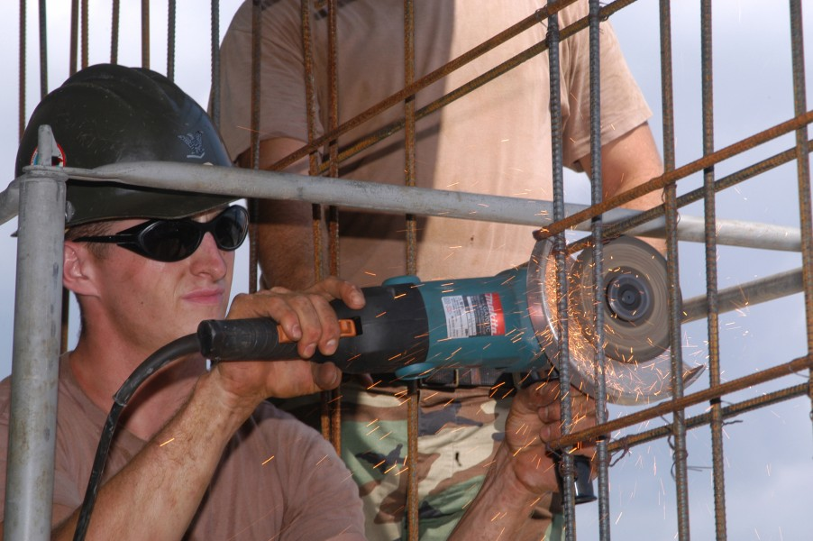 US Navy 040914-N-2970T-029 Builder 3rd Class Mark Dyas, assigned to Naval Mobile Construction Battalion One Three Three (NMCB-133), Detail Sasebo, slices through a steel reinforcement bar