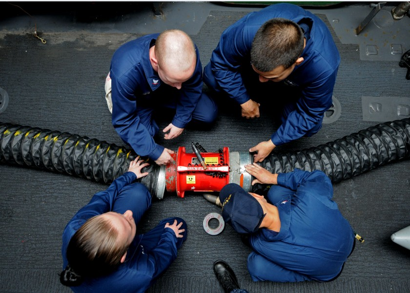 US Navy 101026-N-2908M-006 Sailors aboard the amphibious assault ship USS Kearsage (LHD 3) conduct damage control training on a ventilation fan dur