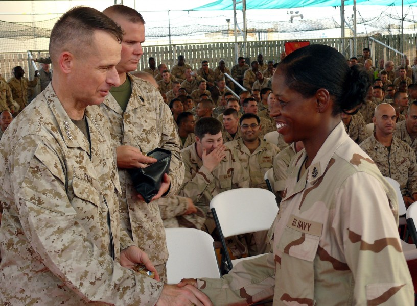 US Navy 070814-F-1779B-219 Chairman of the Joint Chiefs of Staff Gen. Peter Pace gives a challenge coin an U.S. Navy chief petty officer during his Town Hall Meeting at Camp Lemonier