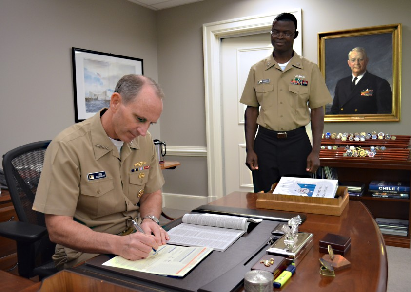 US Navy 111031-N-FC670-004 Chief of Naval Operations (CNO) Adm. Jonathan Greenert reads the Combined Federal Campaign (CFC) pamphlet