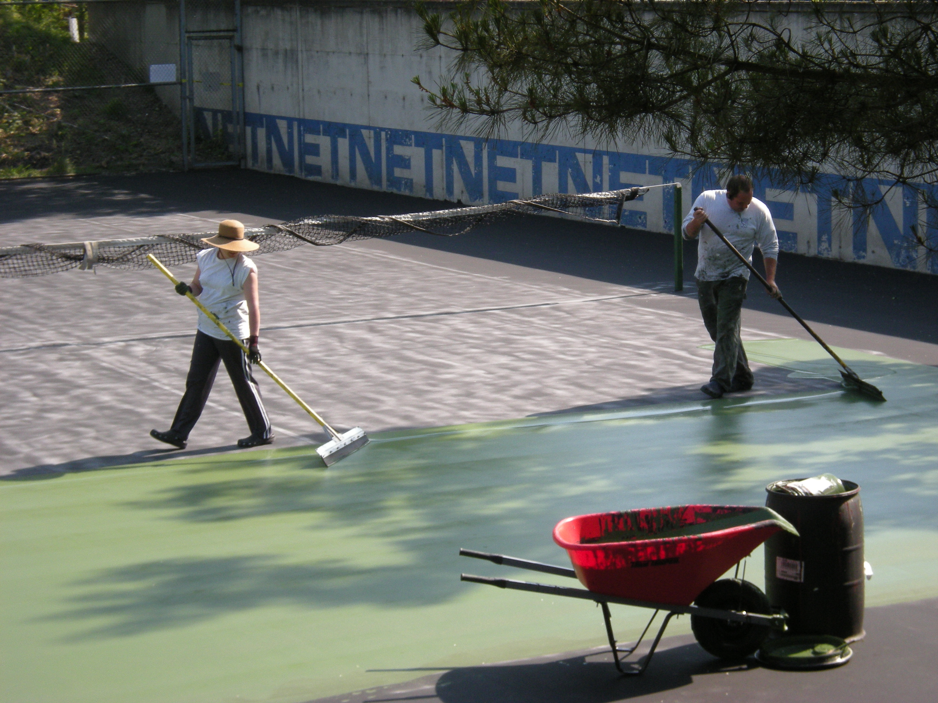 Painting surface of tennis court