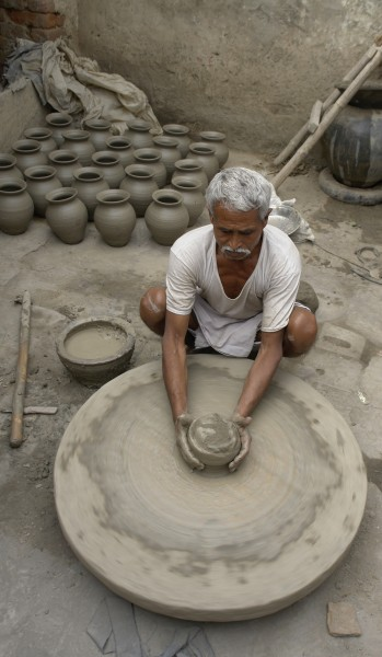 Potter at work, Jaura, India