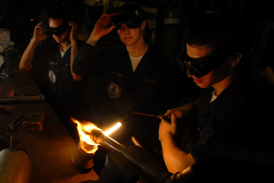 US Navy 070514-N-2659P-165 From left to right, Hull Technician Firemen Noah Rodriguez, Zach Carver and Keir Burnette assist with brazing