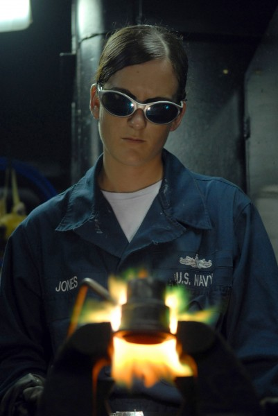 US Navy 080705-N-1635S-003 Hull Technician Fireman Donna Jones, from Mentone, Texas, performs a brazing job in the pipe shop aboard the Nimitz-class aircraft carrier USS Ronald Reagan (CVN 76)