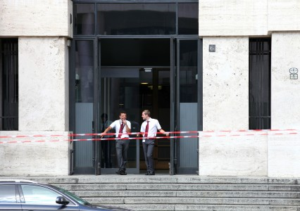 two men near the Italian Stock Exchange in Milan, Italy, European Union, August 2013, picture 53