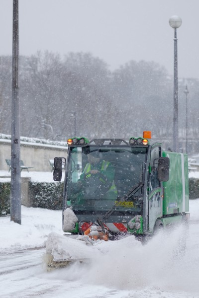 Road sweeper clearing snow away in Paris