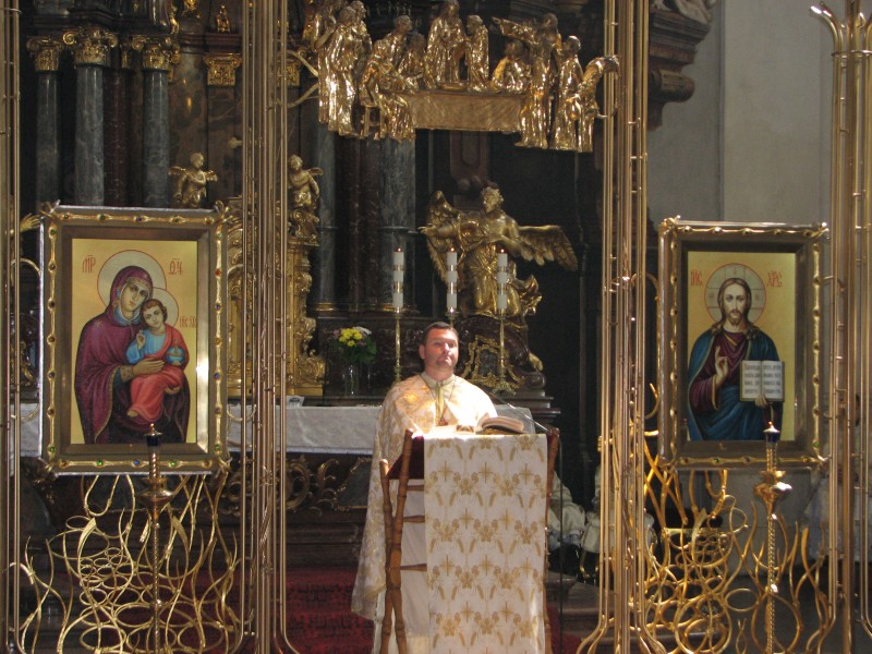 A Catholic priest in a Catholic church in Prague (Praha) city, Czech Republic, European Union
