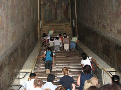People on stairs (brought from the Holy Land) on which Jesus was coming to Pilate. Rome, Italy, European Union, August 2011, picture 27.