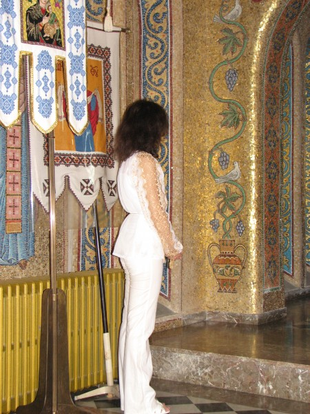 A Catholic girl in a Church in Rome, Italy, European Union, August 2011, picture 15.