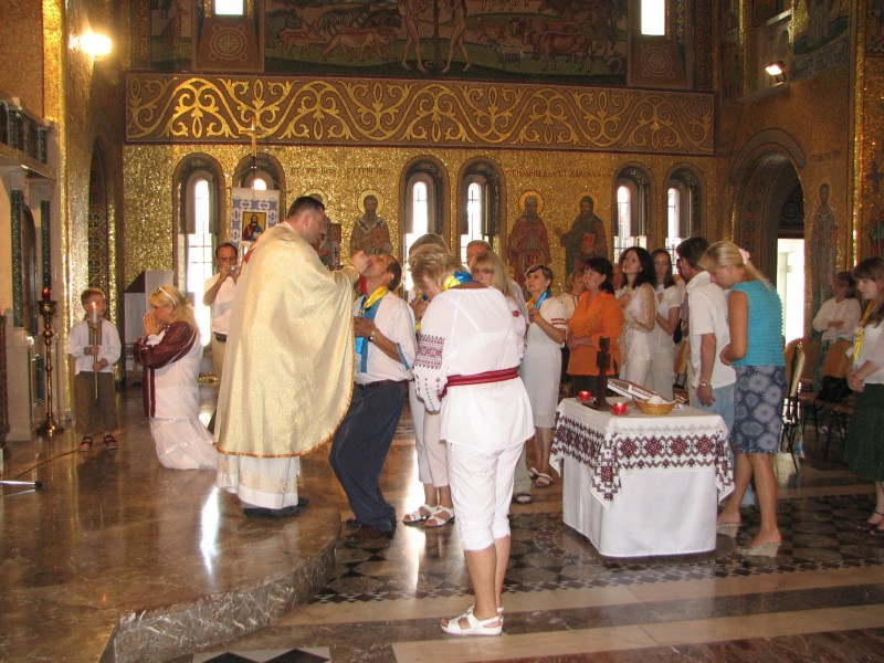 People are taking the Holy Communion in a Greek-Catholic Church in Rome, Italy, European Union, August 2011, picture 17.