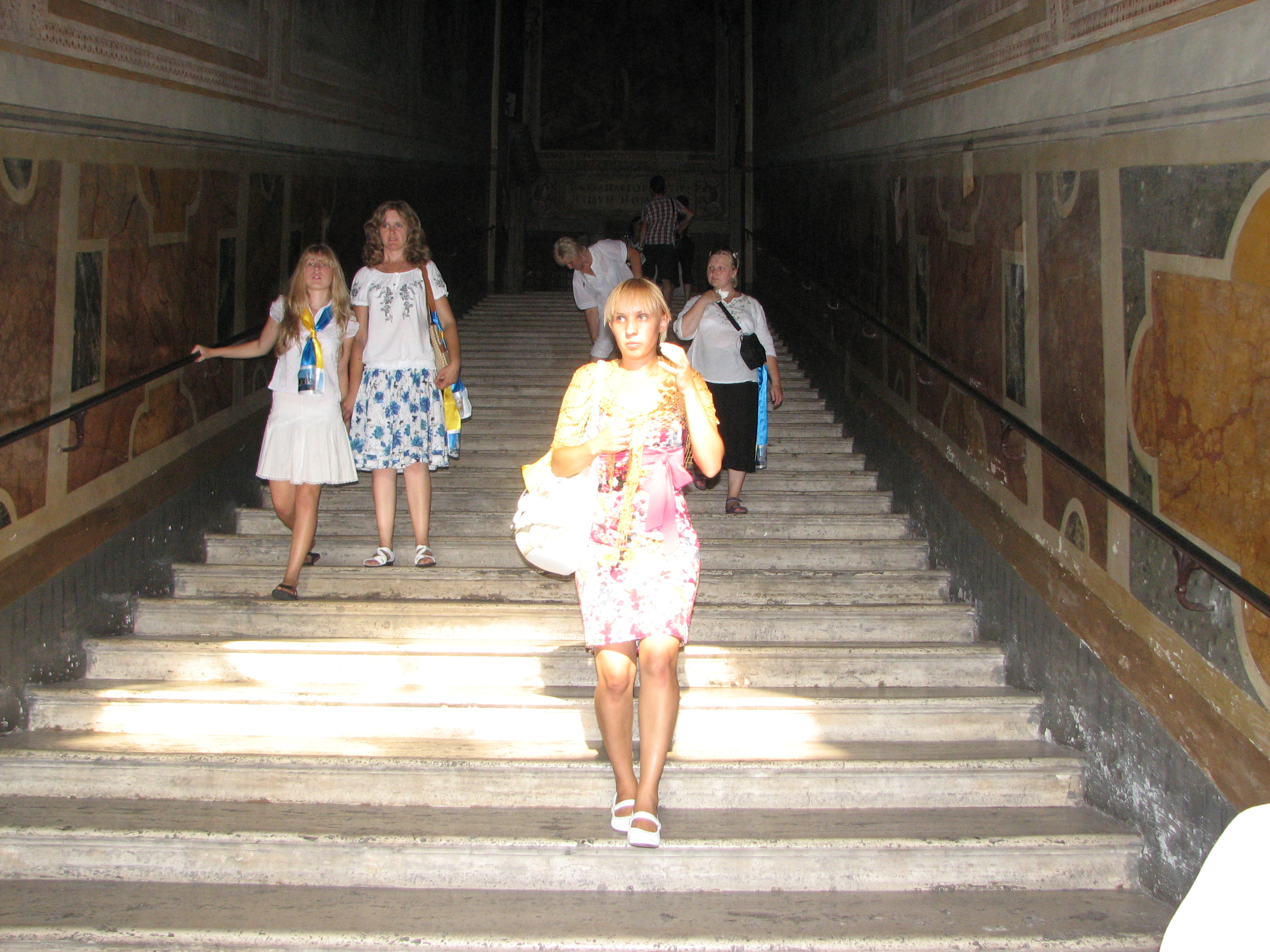 People on stairs (brought from the Holy Land) on which Jesus was coming to Pilate. Rome, Italy, European Union, August 2011, picture 28.