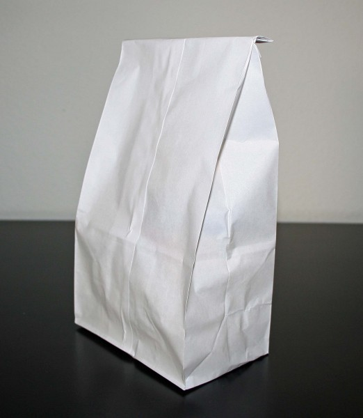 White paper bag on white and black background