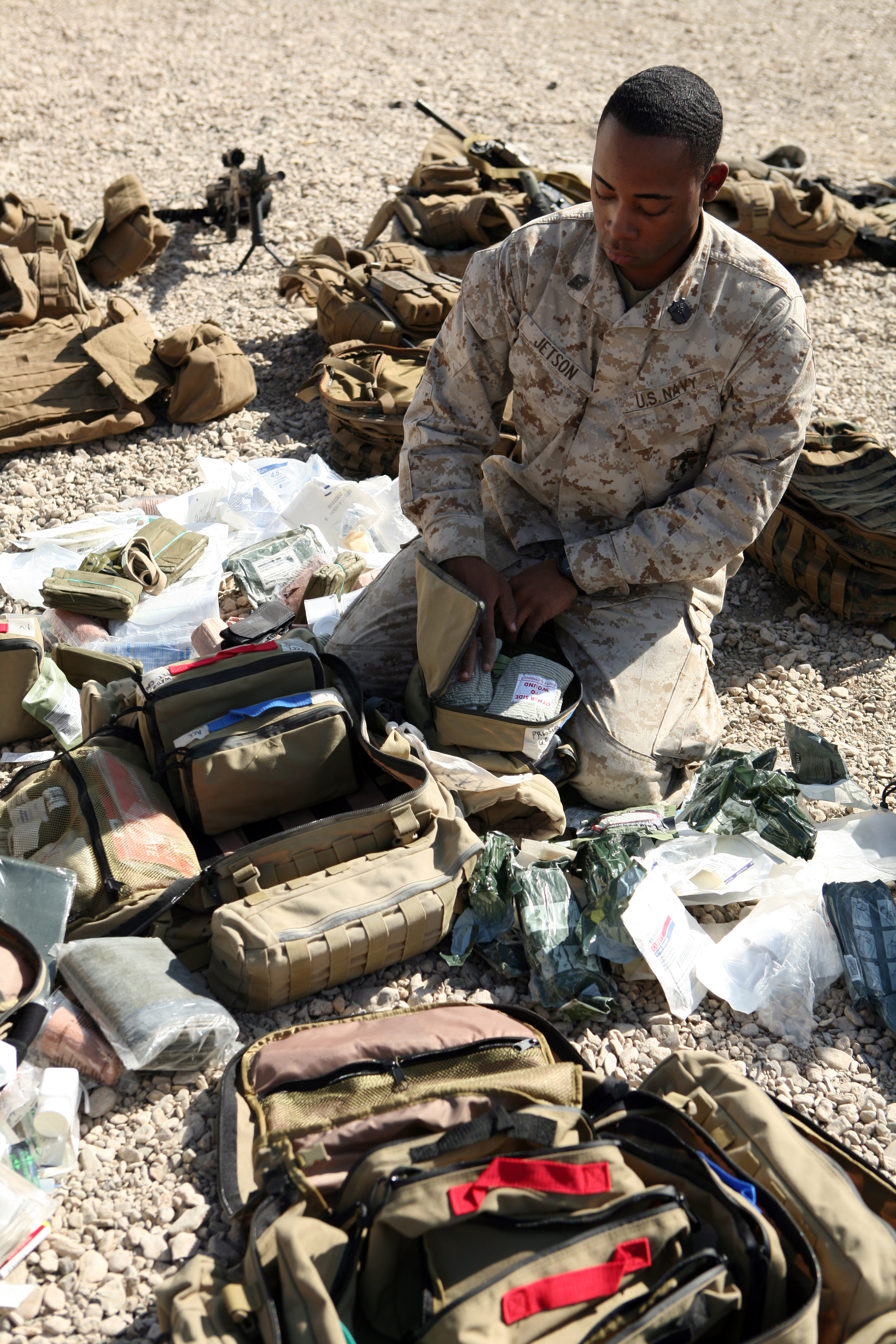 US Navy 081110-M-6159T-017 Hospital Corpsman Lucas Jetson prepares his field medical bag