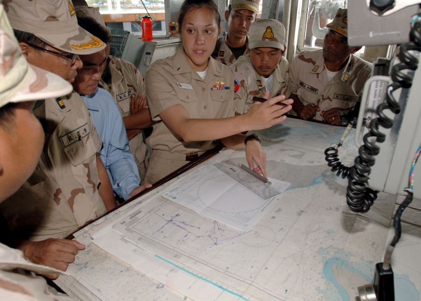 Defense.gov News Photo 101026-N-9156C-004 - U.S. Navy Lt. j.g. Vanessa Walton 4th from right navigator aboard the guided missile frigate USS Crommelin FFG 37 explains to officers with the