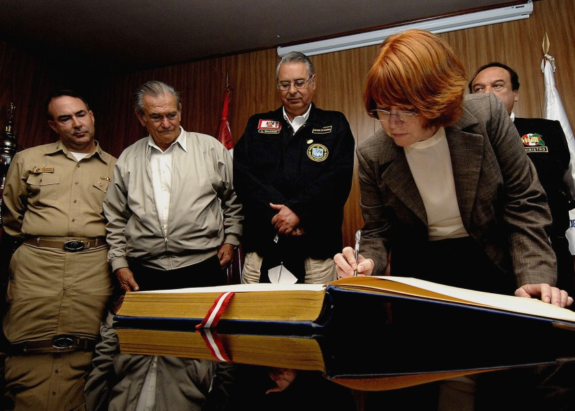 US Navy 070809-N-6278K-166 Caryn Hollis, U.S. Southern Command^rsquo,s director of joint interagency partnering, signs a guest book at Trujillo Regional Teaching Hospital