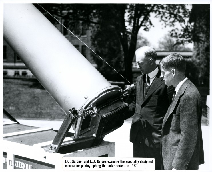 I. C. Gardner and L. J. Briggs examine the specially designed camera for photographing the solar corona in 1937
