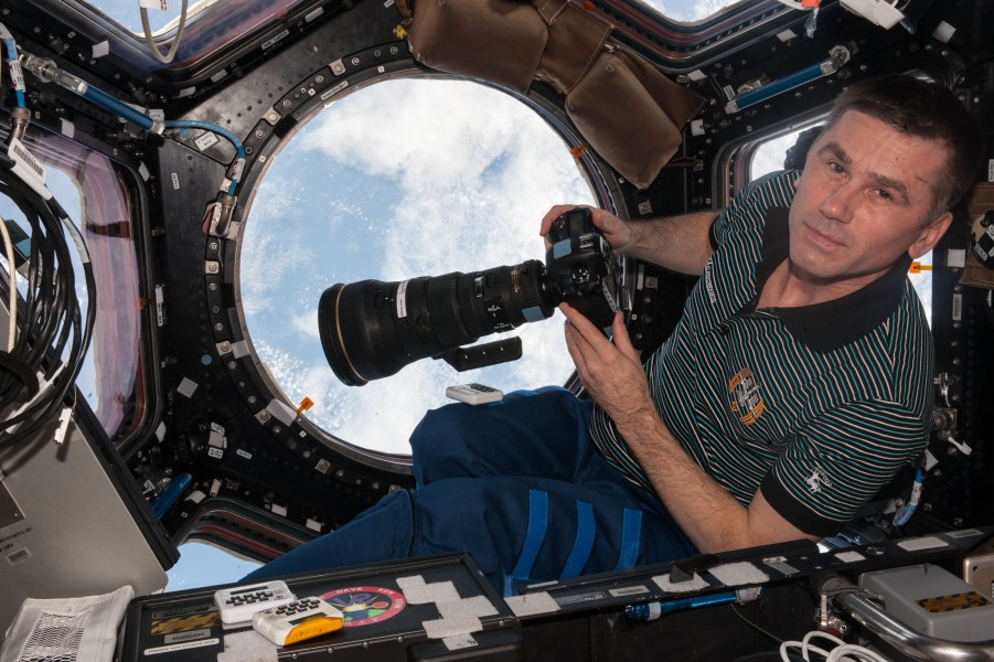ISS-47 Yuri Malenchenko with camera in the Cupola module