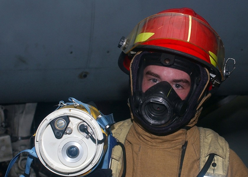 US Navy 041115-N-6125G-006 Fireman Brandon Dossey uses a Naval Firefighters Thermal Imaging (NFTI) system during a fire drill aboard the Nimitz-class aircraft carrier USS Harry S. Truman (CVN 75)