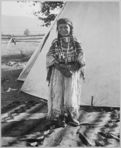 Angelic La Moose, whose grandfather was a Flathead chief, wearing costume her mother made, full-length, standing, in fro - NARA - 519156
