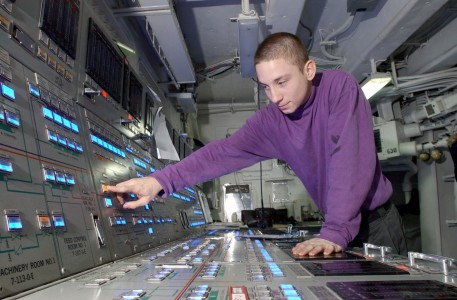 US Navy 031118-N-4768W-038 Aviation Boatswain's Mate 3rd Class Jason Normand, from Marksville, La., operates a jet fuel control console aboard USS John C. Stennis (CVN 74)