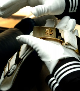 US Navy 040220-N-6213R-008 Airman Pedro Feliciano, of Philadelphia, Pa., shines his belt buckle while traveling to a performance as a member of the U.S. Navy Ceremonial Guard