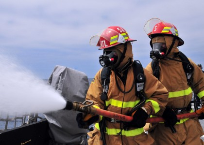 US Navy 080729-N-1488S-021 Midshipmen learn how to operate as members of a hose team aboard the guided-missile destroyer USS Kidd (DDG 100)