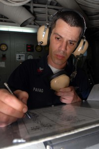 US Navy 081130-N-2456S-049 Aviation Boatswain's Mate (Equipment) 1st Class Tony Pavao logs all open valves in the rundown log