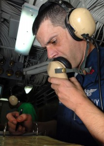 US Navy 081130-N-2456S-073 Aviation Boatswain's Mate (Equipment) 1st Class Tony Pavao ensures all personnel are manned on station