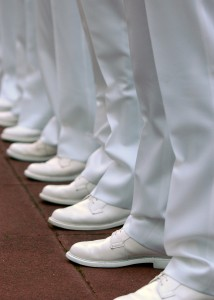US Navy 100406-N-5528G-005 U.S. Naval Academy Midshipmen stand at parade rest during a brigade summer whites uniform inspection