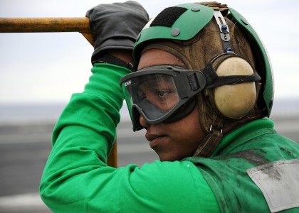 US Navy 100421-N-3885H-153 Aviation Boatswain's Mate (Equipment) Airman Andricio Stinson waits for an aircraft to land aboard the aircraft carrier USS George H.W. Bush (CVN 77)