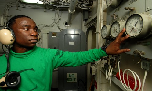 US Navy 100831-N-6582H-046 Aviation Boatswain's Mate (Equipment) 3rd Class Lavon Jackson, from Gadsden, Ala., checks water pressure and temperature gauges in a catapult room