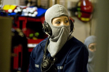 US Navy 110219-N-2953W-164 Hull Maintenance Technician Fireman Apprentice Amanda Mathis relays a message from Damage Control Central during a gener