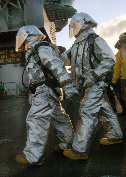 US Navy 040430-N-0119G-003 Sailors assigned to Air Department's Crash and Salvage team prepare to enter the scene of a simulated fire