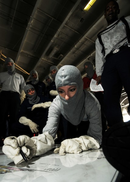 US Navy 080620-N-9898L-050 Yeoman 1st class Julie Eubanks trains in damage control plotting during a general quarters drill aboard Nimitz-class aircraft carrier USS Abraham Lincoln (CVN 72)